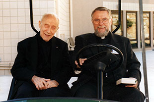 Fr. John A. Hardon in a Golf Cart